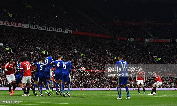 Wayne Rooney of Manchester United shoots from a free kick during the Barclays Premier League match between Manchester United and Leicester City at...