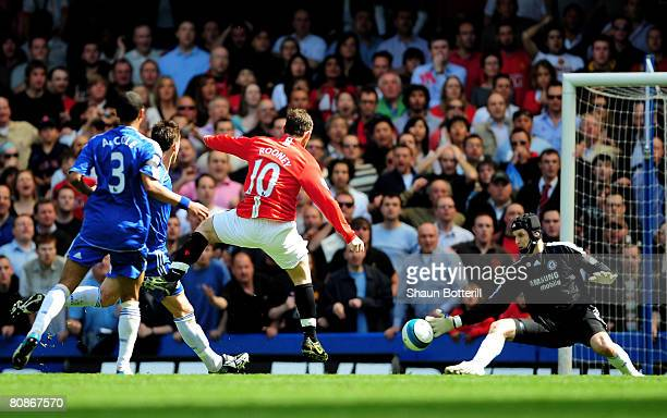 Wayne rooney of Manchester United shoots past Petr Cech of Chelsea to score their first gosl during the Barclays Premier League match between Chelsea...
