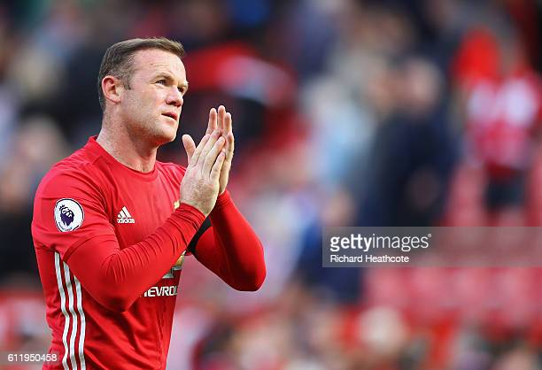 Wayne Rooney of Manchester United shows apperciation to the fans after the game during the Premier League match between Manchester United and Stoke...