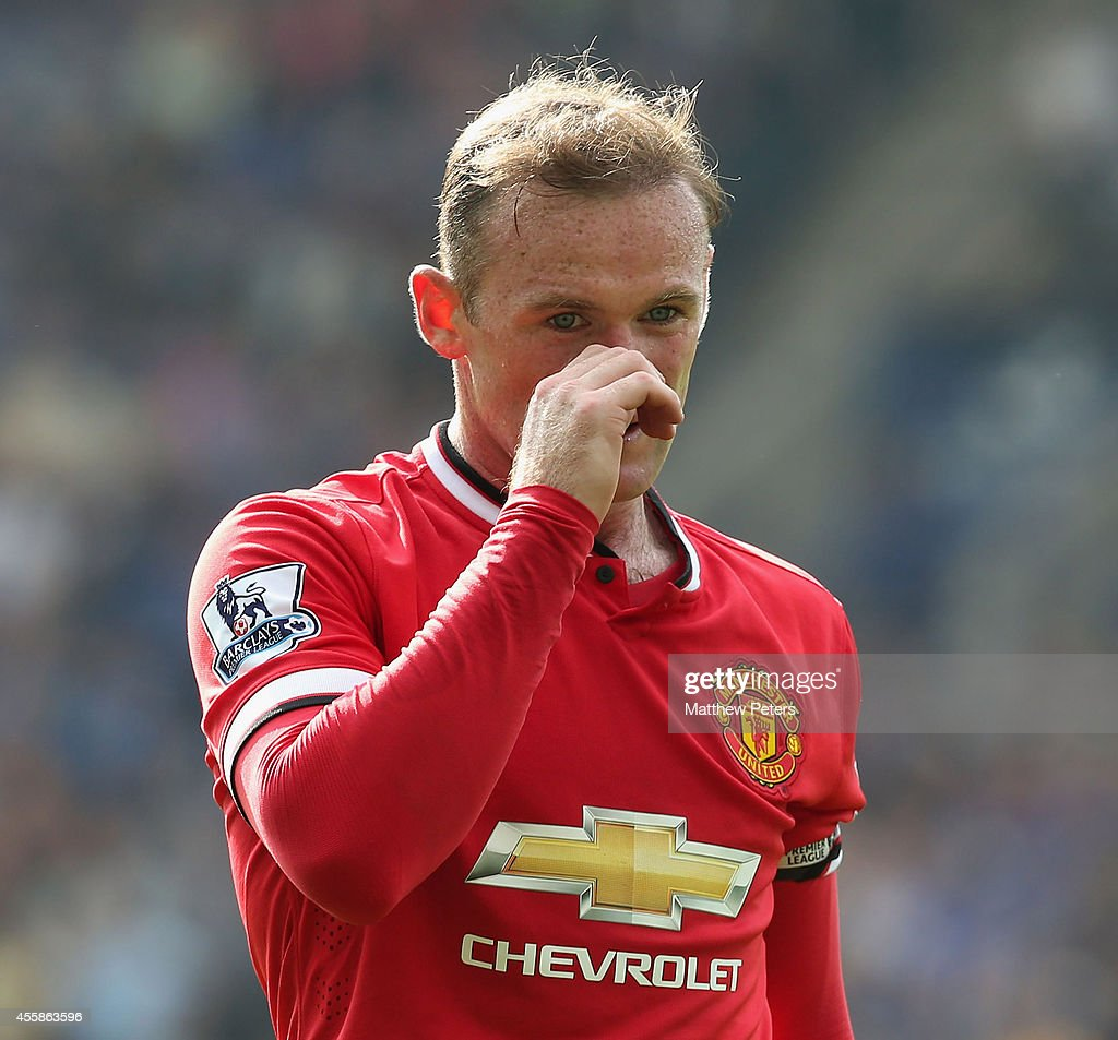 Wayne Rooney of Manchester United shows his disappointment after the Barclays Premier League match between Leicester City and Manchester United at The King Power Stadium on September 21, 2014 in Leicester, England.