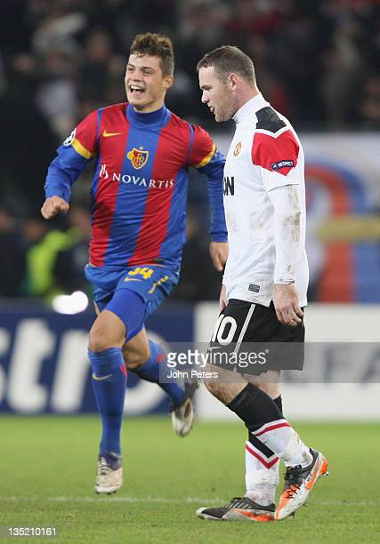 Wayne Rooney of Manchester United shows his disappointment as Granit Xhaka of FC Basel celebrates after the UEFA Champions League Group C match...