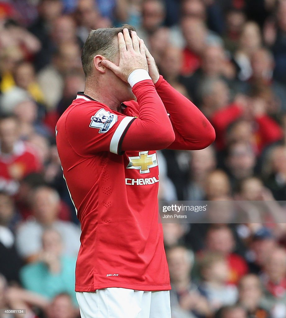 Wayne Rooney of Manchester United shows his disappointment at a missed chance during Premier League match between Manchester United and Swansea City at Old Trafford on August 16, 2014 in Manchester, England.