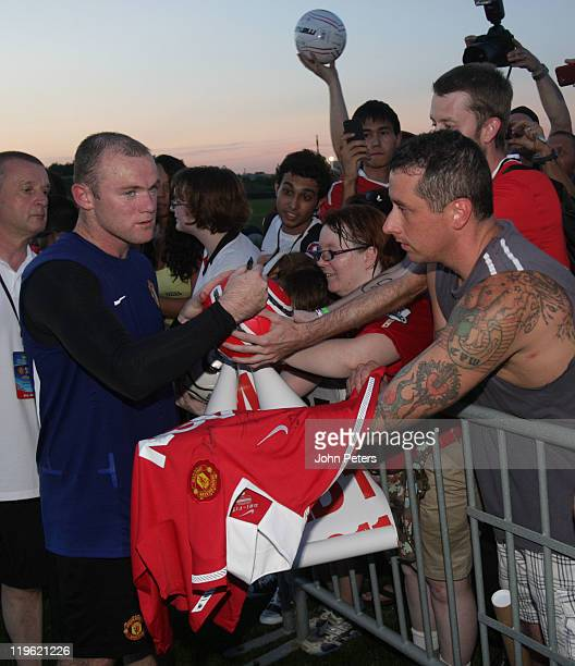 Wayne Rooney of Manchester United signs autographs for fans after a first team training session as part of their pre-season tour of the USA at Toyota...