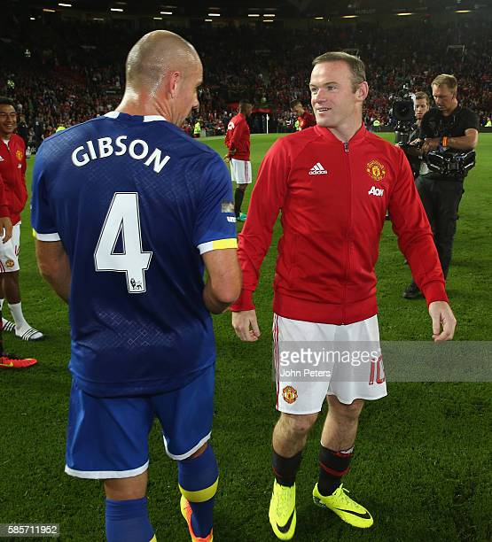 Wayne Rooney of Manchester United speaks to Darron Gibson of Everton after the Wayne Rooney Testimonial match between Manchester United and Everton...
