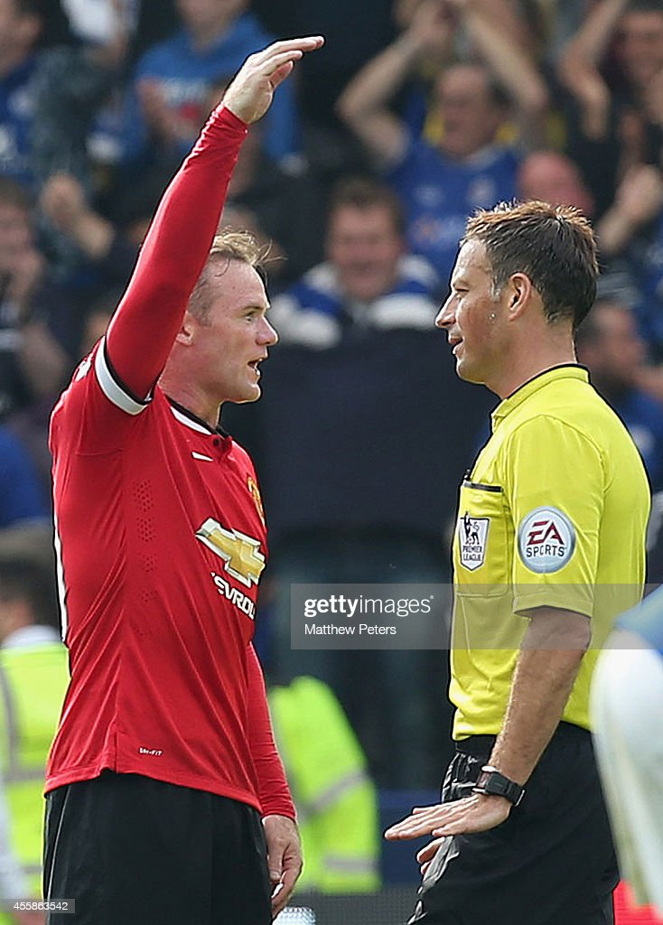 Wayne Rooney of Manchester United speaks to referee Mark Clattenburg during the Barclays Premier League match between Leicester City and Manchester United at The King Power Stadium on September 21, 2014 in Leicester, England.
