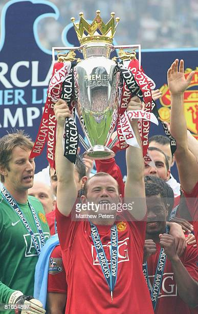 Wayne Rooney of Manchester United squad lifts the Premiership trophy after the Barclays FA Premier League match between Wigan Athletic and Manchester...