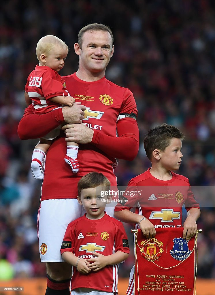 Wayne Rooney of Manchester United stands with his three children Kai, Klay and Kit Rooney during the Wayne Rooney Testimonial match between Manchester United and Everton at Old Trafford on August 3, 2016 in Manchester, England.