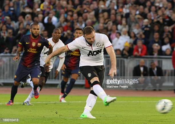 Wayne Rooney of Manchester United takes a penalty during the pre-season friendly match between Manchester United and Barcelona on August 8, 2012 in...