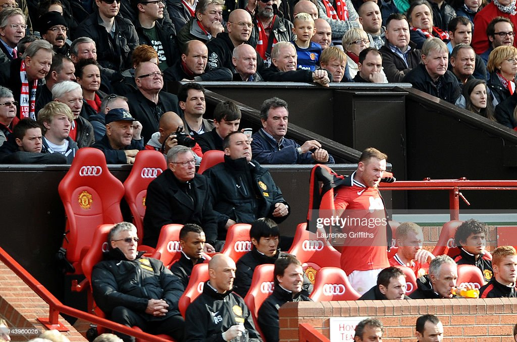 Wayne Rooney of Manchester United takes his seat on the bench after being substituted during the Barclays Premier League match between Manchester United and Swansea City at Old Trafford on 6 May 2012 in Manchester, England.