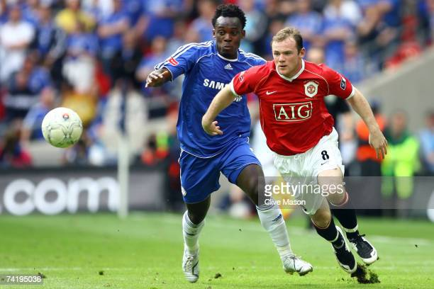 Wayne Rooney of Manchester United takes on Michael Essien of Chelsea during the FA Cup Final match sponsored by EON between Manchester United and...