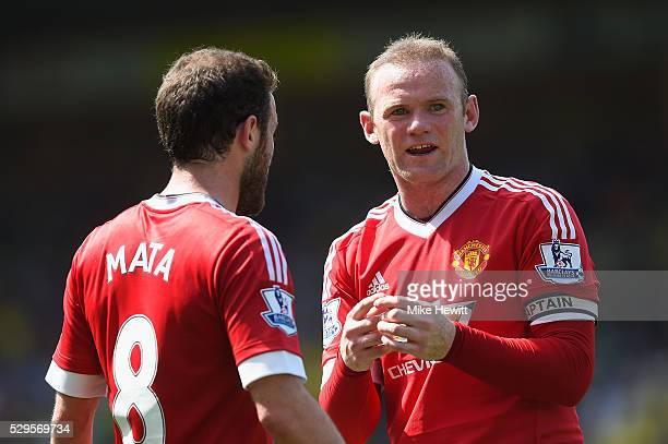 Wayne Rooney of Manchester United talks to Juan Mata during the Barclays Premier League match between Norwich City and Manchester United at Carrow...