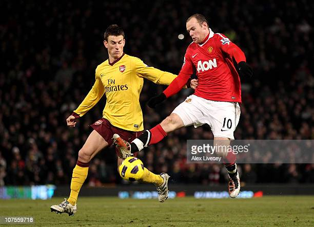 Wayne Rooney of Manchester United tangles with Laurent Koscielny of Arsenal during the Barclays Premier League match between Manchester United and...