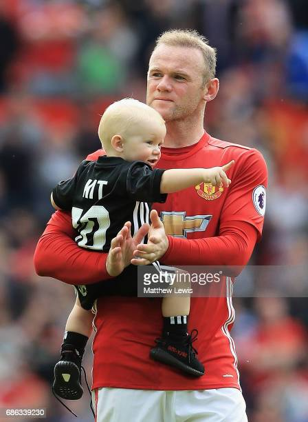Wayne Rooney of Manchester United thanks the crowd with his son Kit after the Premier League match between Manchester United and Crystal Palace at...