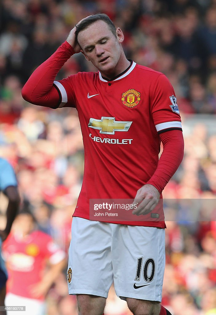 Wayne Rooney of Manchester United walks off after being sent off during the Barclays Premier League match between Manchester United and West Ham United at Old Trafford on September 27, 2014 in Manchester, England.
