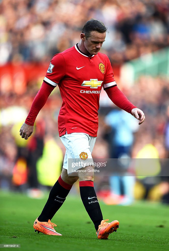 Wayne Rooney of Manchester United walks off the pitch after receiving a straight red card following a foul on Stewart Downing of West Ham during the Barclays Premier League match between Manchester United and West Ham United at Old Trafford on September 27, 2014 in Manchester, England.