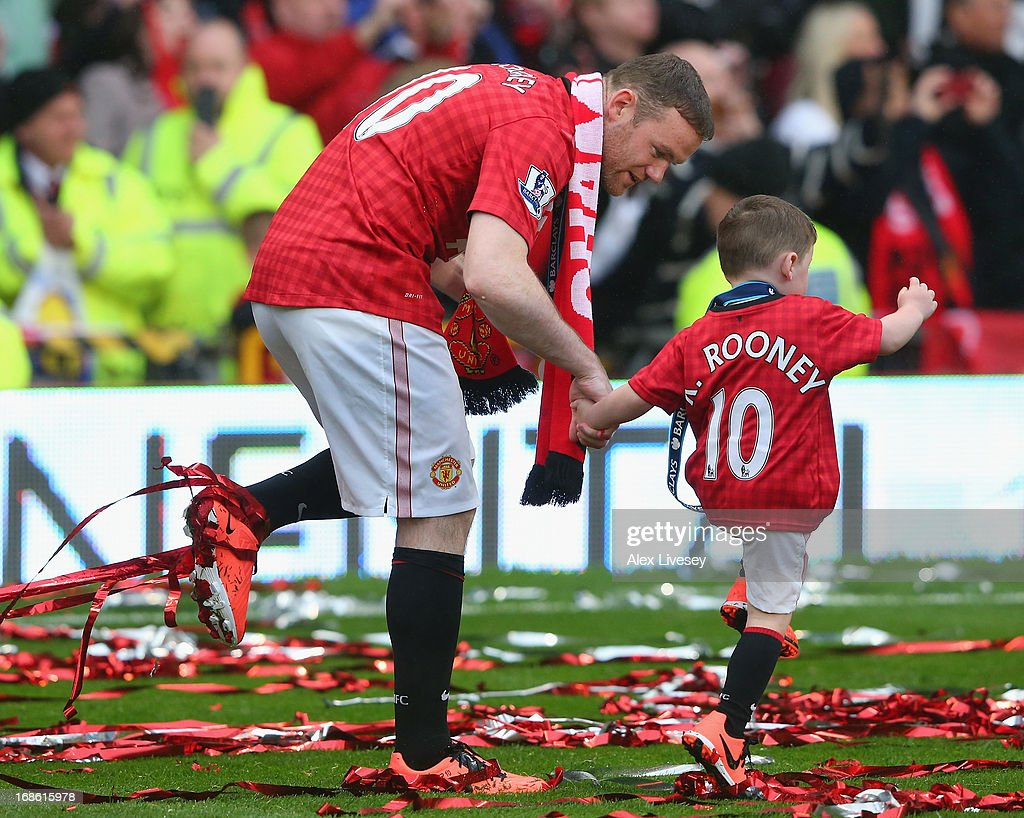 Wayne Rooney of Manchester United walks with his son Kai following the Barclays Premier League match between Manchester United and Swansea City at Old Trafford on May 12, 2013 in Manchester, England.