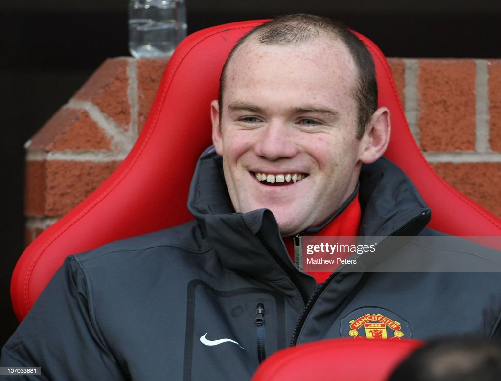 Wayne Rooney of Manchester United watches from the bench during the Barclays Premier League match between Manchester United and Wigan Athletic at Old Trafford on November 20, 2010 in Manchester, England.