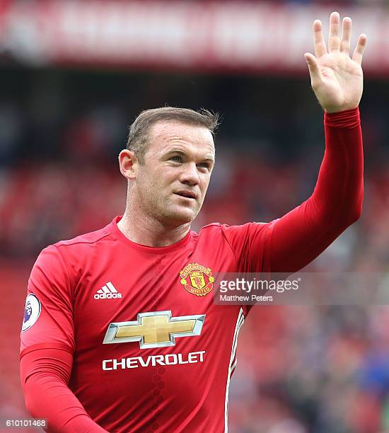 Wayne Rooney of Manchester United waves at the end of the Premier League match between Manchester United and Leicester City at Old Trafford on...