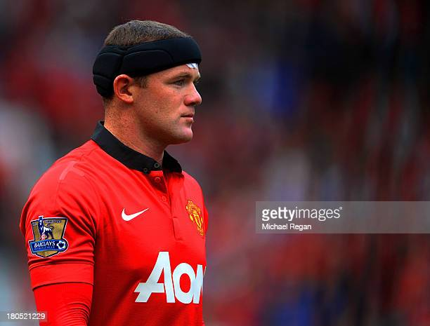 Wayne Rooney of Manchester United wears protective headwear during the Barclays Premier League match between Manchester United and Crystal Palace at...