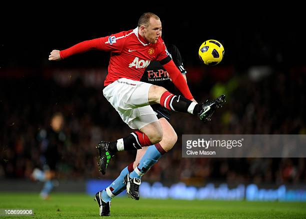 Wayne Rooney of Manchester United wins the ball prior to scoring the opening goal during the Barclays Premier League match between Manchester United...
