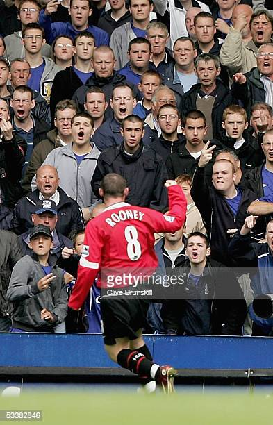 Wayne Rooney of Manchester Utd is acknowledged by the Everton fans after the first goal during the Barclays Premiership match between Everton and...