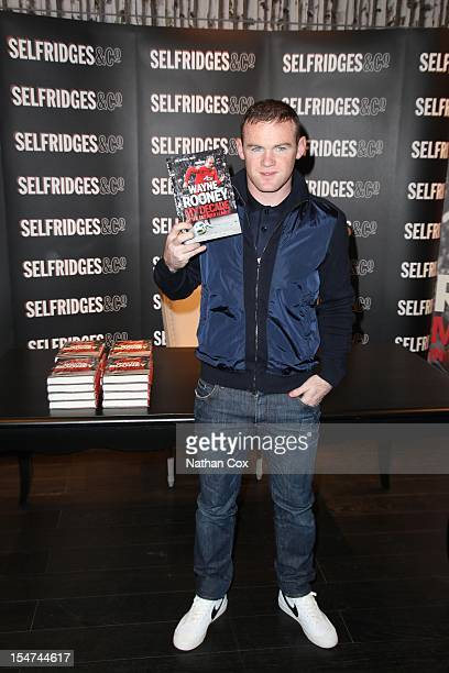 Wayne Rooney poses with a copie of his book 'My Decade in the Premier League' at Selfridges Trafford Centre at WHSmith Manchester on October 25 2012...