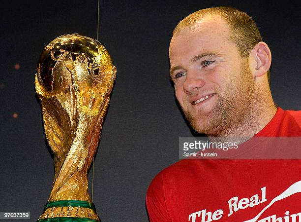 Wayne Rooney poses with the authentic FIFA World Cup Trophy as part of the FIFA World Cup Trophy Tour on March 11 2010 at Earls Court in London...