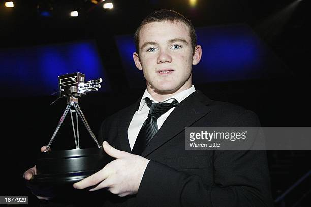 Wayne Rooney poses with the BBC Young Sports Personality of the Year Award at BBC Television Centre in London on December 8 2002