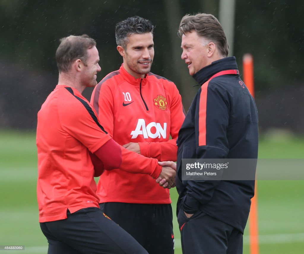 Wayne Rooney, Robin van Persie and Manager Louis van Gaal of Manchester United in action during a first team training session at Aon Training Complex on August 29, 2014 in Manchester, England.