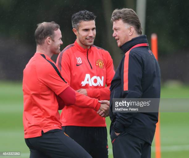 Wayne Rooney, Robin van Persie and Manager Louis van Gaal of Manchester United in action during a first team training session at Aon Training Complex...
