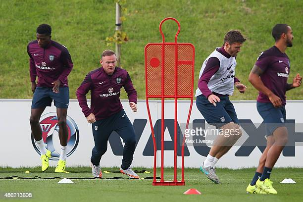 Wayne Rooney runs through drills with teammates during the England training session at St Georges Park on September 2 2015 in BurtonuponTrent England