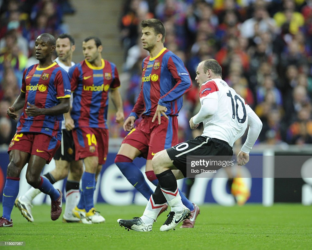 Wayne Rooney scores for Manchester United during the UEFA Champions League final between FC Barcelona and Manchester United FC at Wembley Stadium on May 28, 2011 in London, England. Barcelona won the match 3-1.