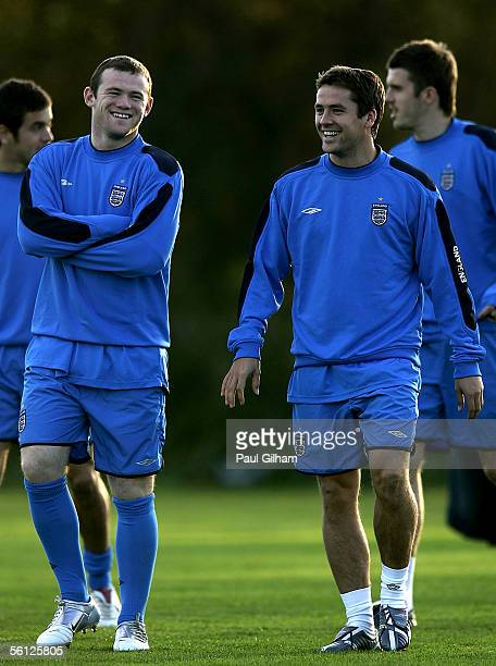 Wayne Rooney shares a joke with Michael Owen during an England Training session ahead of the match Between England and Argentina at Manchester United...