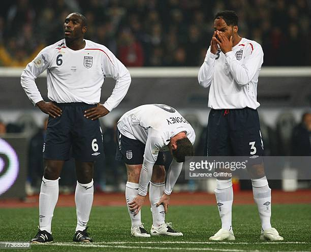 Wayne Rooney Sol Campbell and Joleon Lescott of England show their disappointment after conceding a penalty during the Euro 2008 qualifying match...