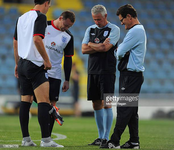 Wayne Rooney speaks to Fabio Capello during the England training session ahead of their UEFA EURO 2012 Group G qualifier against Montenegro at...