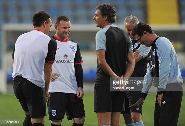 Wayne Rooney speaks to manager Fabio Capello during the England training session ahead of their UEFA EURO 2012 Group G qualifier against Montenegro...