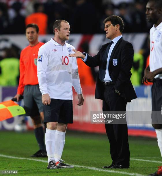Wayne Rooney talks to Fabio Capello during the FIFA 2010 World Cup Group 6 Qualifying match between Ukraine and England at the Dnipro Arena on...