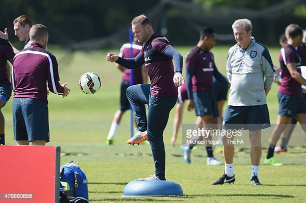 Wayne Rooney warms up as england manager Roy Hodgson looks on during the England training session on June 11, 2015 in St Albans, England.