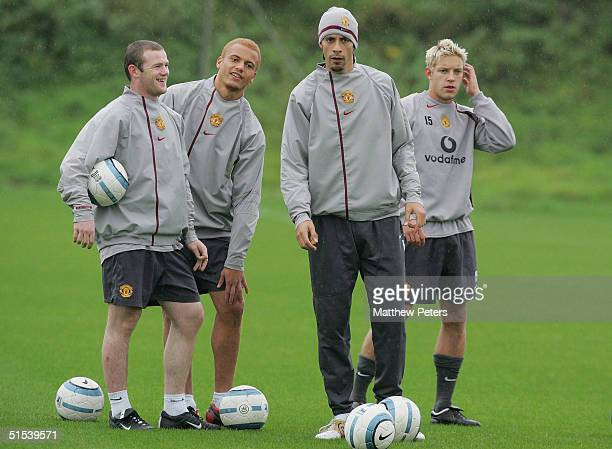 Wayne Rooney Wes Brown Rio Ferdinand and Alan Smith of Manchester United in action during a first team training session at Carrington Training Ground...