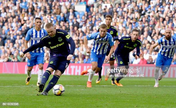 Wayne Rooneyof Everton scores a penalty during the Premier League match between Brighton and Hove Albion and Everton at Amex Stadium on October 15...
