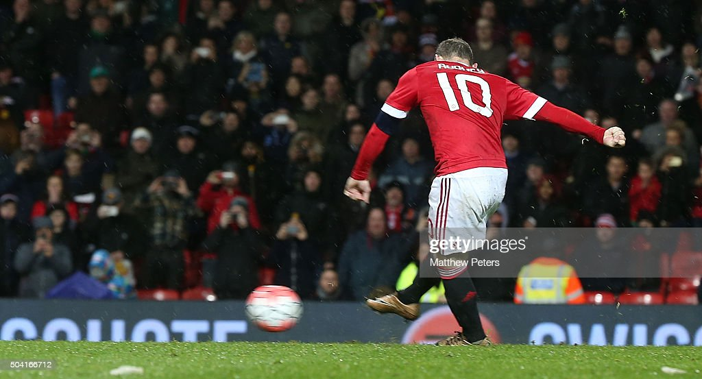 Wayne Rooneyof Manchester United scores their first goal during the Emirates FA Cup Third round match between Manchester United and Sheffield United at Old Trafford on January 9, 2016 in Manchester, England.