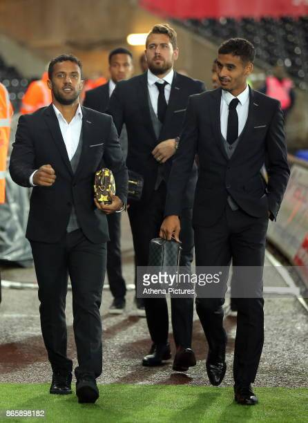 Wayne Routledge Kristoffer Nordfeldt and Kyle Naughton of Swansea City arrive prior to the game during the Carabao Cup Fourth Round match between...