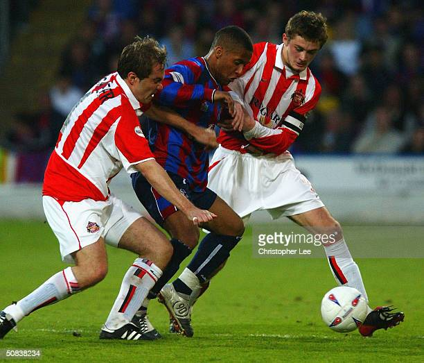 Wayne Routledge of Crystal Palace battles with Jason McAteer and George McCartney of Sunderland during the Nationwide Division One Playoff First Leg...