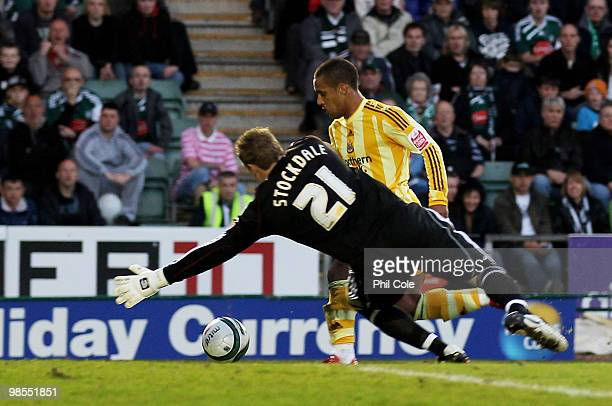 Wayne Routledge of Newcastle United goes round David Stockdale of Plymouth Argyle to score during the Coca Cola Championship match between Plymouth...