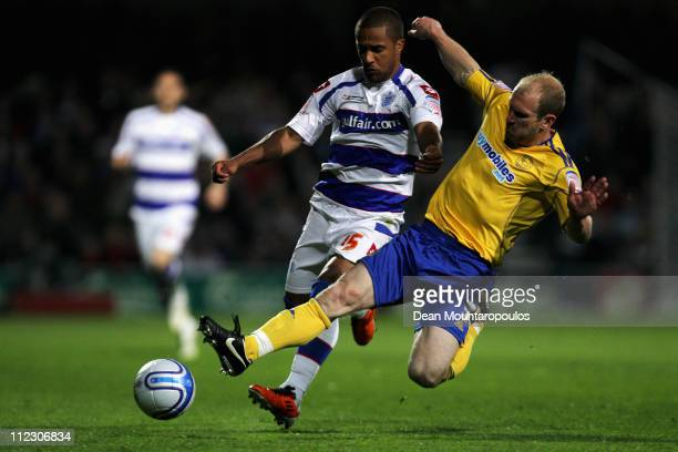 Wayne Routledge of QPR and Gareth Roberts of Derby battle for the ball during the npower Championship match between Queens Park Rangers and Derby...