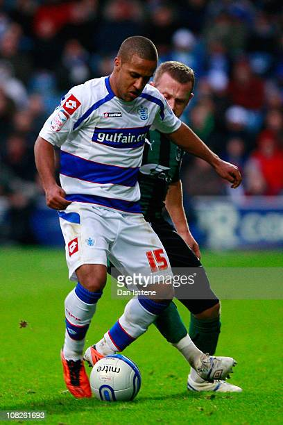 Wayne Routledge of QPR battles for the ball with Sammy Clingan of Coventry during the npower Championship match between Queens Park Rangers and...