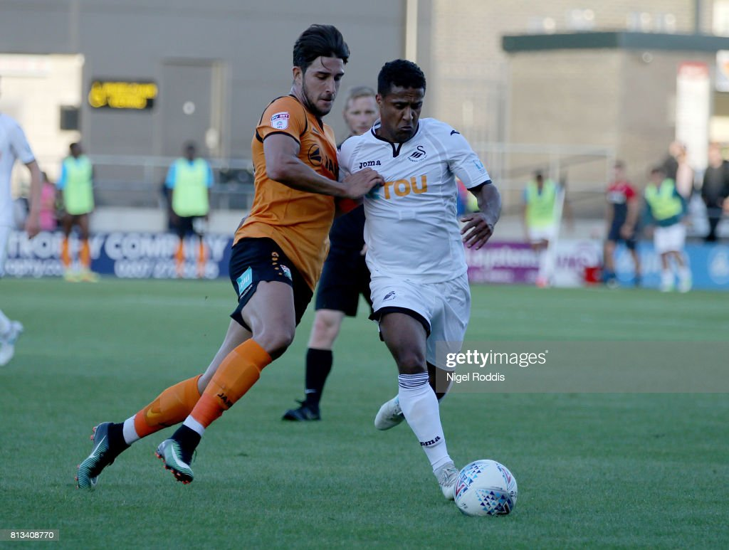 Wayne Routledge of Swansea (R) challenges Dan Sweeney of Barnet during the pre season friendly match between Barnet and Swansea City at The Hive on July 12, 2017 in Barnet, England.