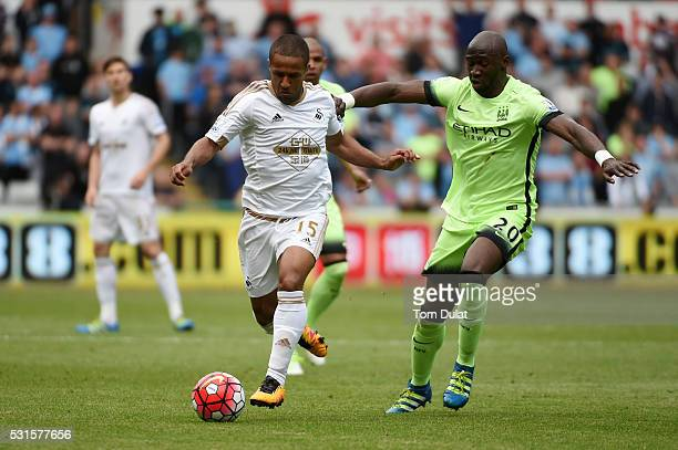 Wayne Routledge of Swansea City and Eliaquim Mangala of Manchester City compete for the ball during the Barclays Premier League match between Swansea...