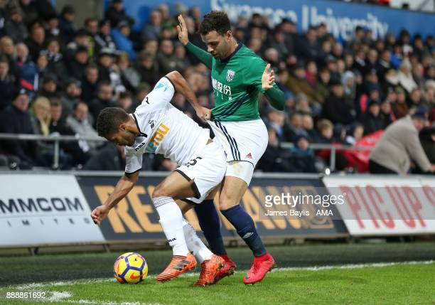 Wayne Routledge of Swansea City and Hal RobsonKanu of West Bromwich Albion during the Premier League match between Swansea City and West Bromwich...