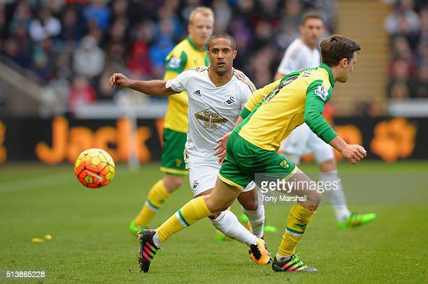 Wayne Routledge of Swansea City and Jonathan Howson of Norwich City compete for the ball during the Barclays Premier League match between Swansea...